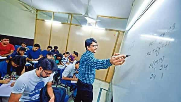 Students continue to face competitive entrance exams for higher education, meaning there is a parallel system of cramming through coaching centres to meet the demand. (Photo: Mint)