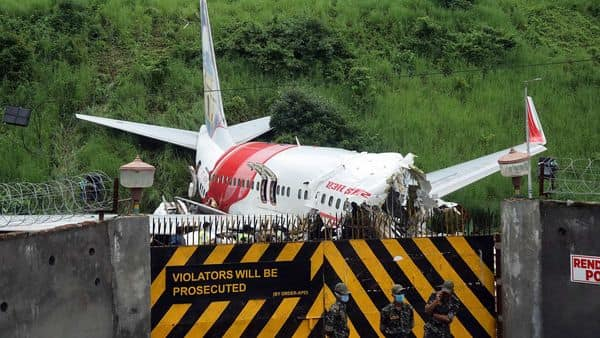 Wreckage of Air India Express flight at Kozhikode International Airport in Karipur. 18 people including two pilots lost their lives when the Dubai-Kozhikode Air India flight (IX-1344) crash landed at Kozhikode International Airport. (ANI)