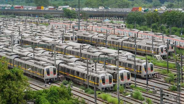 Metro trains stand parked at a yard, after services were closed for commuters in the wake of coronavirus pandemic, at Timarpur in New Delhi. (PTI)