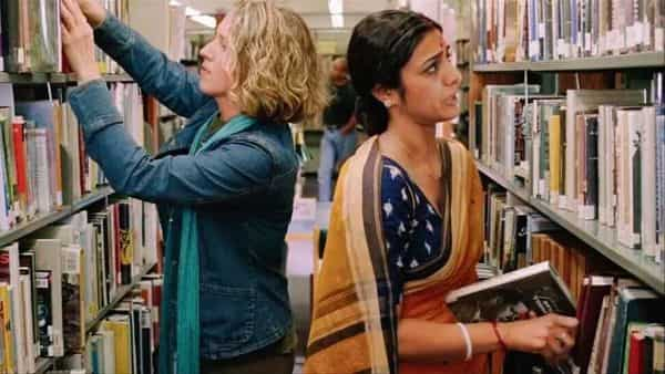 A still from Mira Nair's 'Namesake', based on Jhumpa Lahiri's 2003 novel. Librarian Ashima Ganguli, played by Tabu, holds a copy of Dylan Thomas' poems.