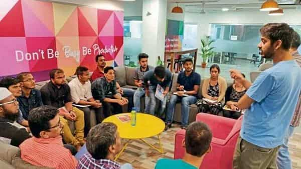 Prateek Shukla (right), co-founder and CEO of Masai School, which started coding bootcamps in June 2019, addresses a batch of students.