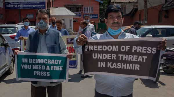 Kashmiri journalists hold placards during a protest against a new media policy that was announced last month in Srinagar, (AP Photo/ Dar Yasin) (AP)