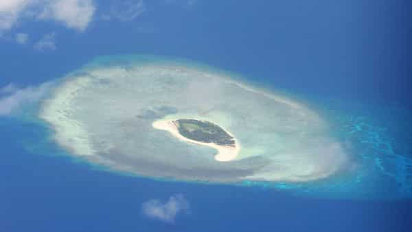 (FILES) This file photo taken on April 21, 2017 shows an aerial shot of a reef in the disputed Spratly islands.  (AFP)