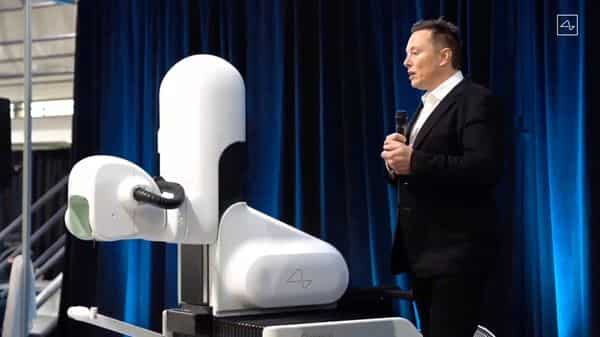Elon Musk standing next to the surgical robot during his Neuralink presentation on August 28, 2020