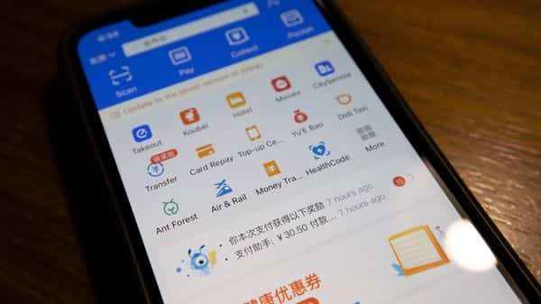 The app for Alipay, the mobile payments service operated by Ant Group, is seen on a smartphone in Beijing. (AP)
