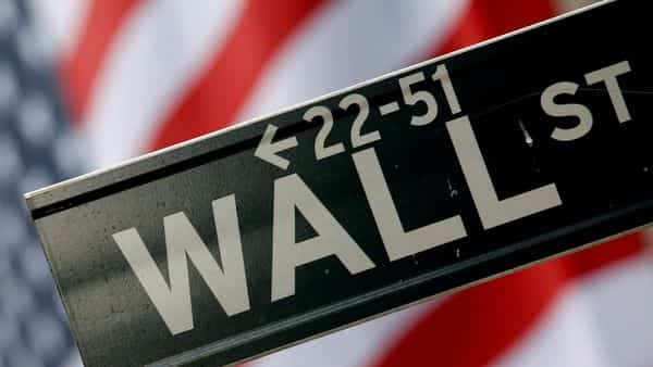 A street sign is seen in front of the New York Stock Exchange on Wall Street in New York. (REUTERS)