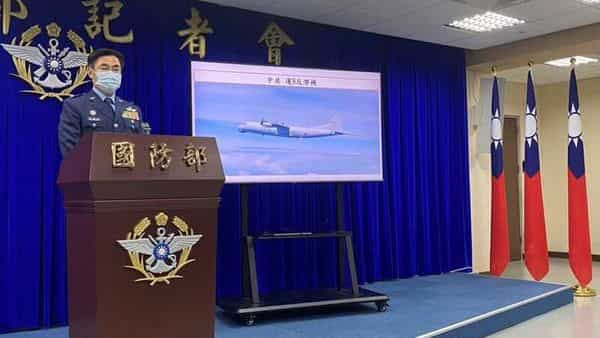 Young Ching-se, deputy intelligence chief of Taiwan defense ministry, speaks next to a screen showing Chinese Y-8 transport aircraft at a news conference about Chinese military drills near Taiwan, in Taipei, Taiwan (REUTERS)