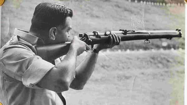 P.G. Halarnkar, your columnist's father, fires a .303 rifle during the early days of his police career, sometime in the late 1950s. Courtesy Samar Halarnkar