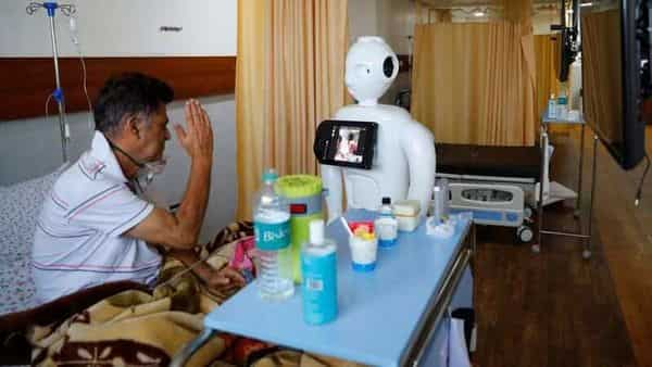 A patient suffering from the coronavirus disease (COVID-19) speaks to his family members, using a robot named 'Mitra' at the Intensive Care Unit (ICU) of the Yatharth Super Speciality Hospital in Noida, on the outskirts of New Delhi, India, September 15, 2020. Picture taken September 15, 2020. REUTERS/Adnan Abidi (REUTERS)