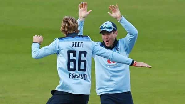 Cricket - Third One Day International - England v Australia - Emirates Old Trafford, Manchester - September 16, 2020 England's Joe Root celebrates with Eoin Morgan after taking the wicket of Australia's Mitchell Marsh Pool via REUTERS/Shaun Botterill (Pool via REUTERS)