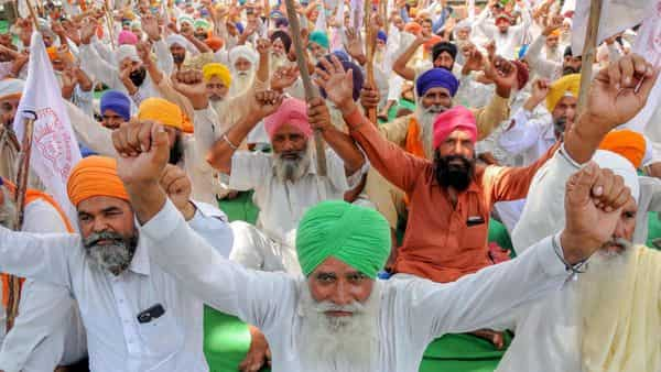 Farmers shout slogans against Prime Minister Narendra Modi and Punjab Chief Minister Captain Amarinder Singh during a protest over various farmers' issues, in Amritsar. (PTI)