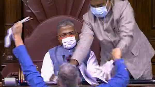 TMC MP Derek O'Brien attempts to tear the rule book as ruckus erupts in the Rajya Sabha over agriculture related bills, during the ongoing Monsoon Session, at Parliament House in New Delhi (PTI)
