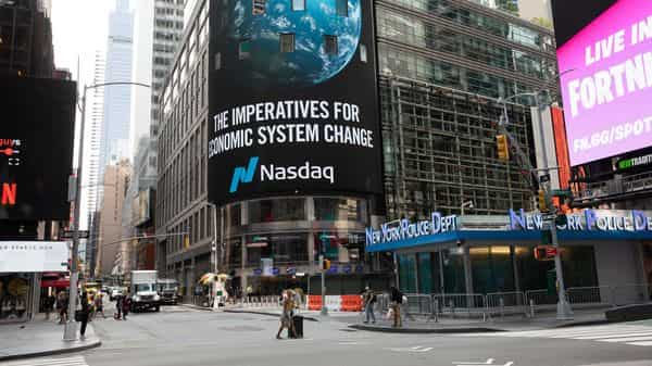 Signage hangs on display outside the Nasdaq MarketSite in the Times Square neighborhood of New York, U.S., on Monday, Sept. 14, 2020. U.S. stocks touched a more than one-week high amid a flurry of�deal activity�and signs of progress toward a coronavirus vaccine. The dollar weakened and Treasuries were little changed. Photographer: Michael Nagle/Bloomberg (Bloomberg)