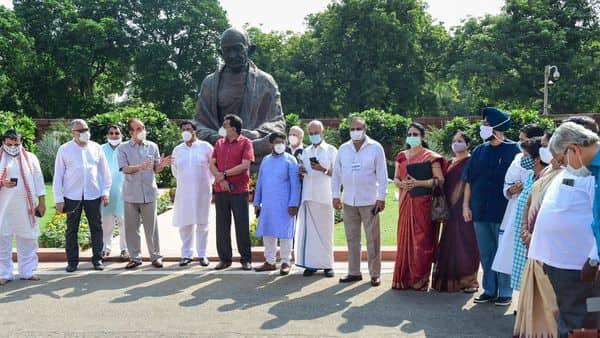 Congress MP Ghulam Nabi Azad and other opposition MPs protest in front of Mahatma Gandhi statue, demanding suspension of 8 lawmakers be revoked, during the ongoing Monsoon Session of Parliament, at Parliament House in New Delhi, Tuesday. (PTI)