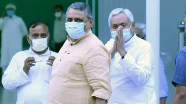 Patna: JD(U) leader and Bihar CM Nitish Kumar with Assembly Speaker Vijay Chaudhary arrives at the party office to interact with ticket seekers. (PTI)