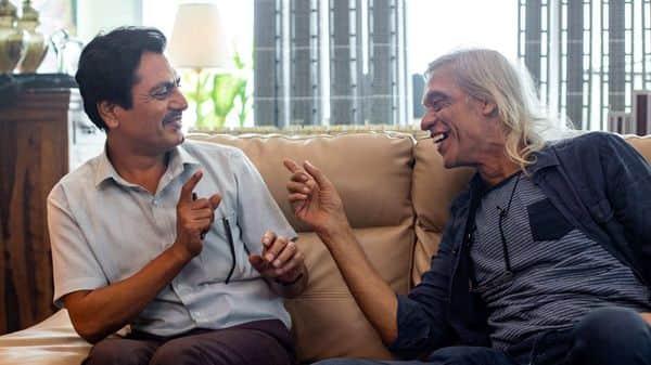 Sudhir Mishra and (left) Nawazuddin Siddiqui on the sets of 'Serious Men'. Courtesy: Netflix