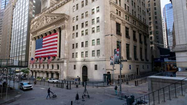 FILE - In this Monday, Sept. 21, 2020 file photo, a giant American Flag hangs on the New York Stock Exchange. Wall Street is rallying Wednesday, Sept. 30 on rising hopes that Washington may pierce through its paralyzing partisanship to offer more aid for the economy. (AP Photo/Mary Altaffer, File) (AP)