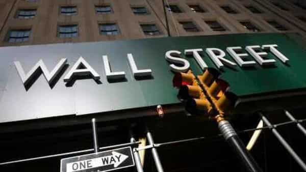 A sign for a Wall Street building is shown in New York (AP)