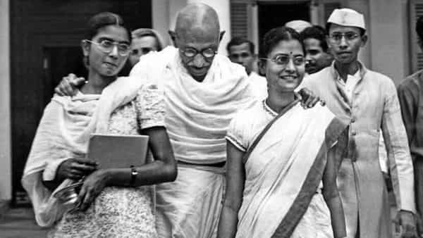 Gandhi with Manu Gandhi (left) and Abha Gandhi.