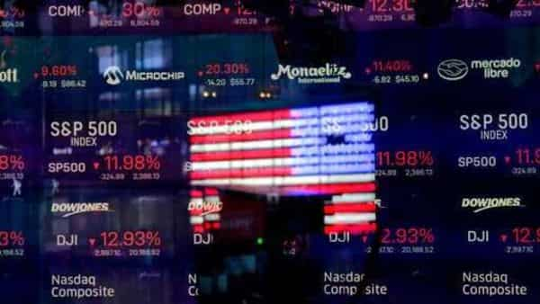 A United States flag is reflected in the window of the Nasdaq studio in Times Square, New York. (AP)