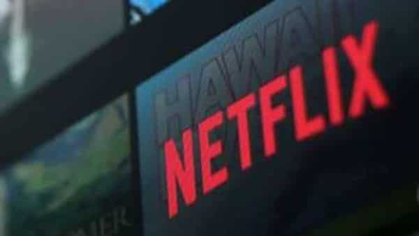 The Netflix logo is pictured on a television in this illustration photograph. (REUTERS)