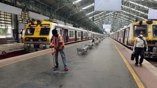 Western Railway employees cleaning Churchgate station. (ANI)