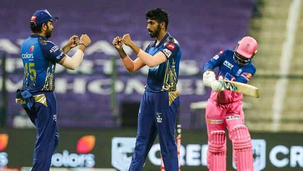 Mumbai Indians skipper Rohit Sharma and player Jasprit Bumrah celebrate the wicket of Rajasthan Royals player Rahul Tewatia during IPL 2020 cricket match, at Sheikh Zayed Stadium in Abu Dhabi, United Arab Emirates, Tuesday (PTI)