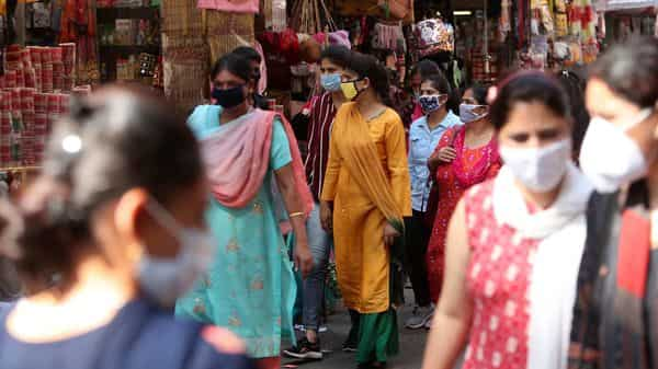 Indians wearing face masks as a precaution against the coronavirus walk in a market in Jammu, India, Friday, Oct. 9, 2020. (AP)