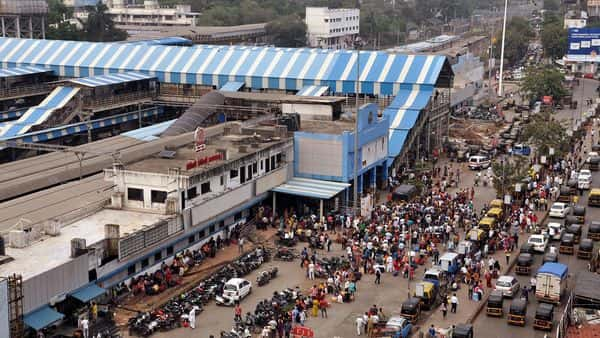 Commuters wait outside Borivali Railway Station as train services shut down after a grid failure that resulted in massive power outages across the city, in Mumbai on Monday. (ANI)