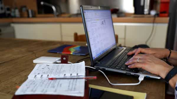 A worker uses a laptop computer whilst working from hom. (Bloomberg)