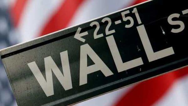 Wall Street surges on Apple, Microsoft, Amazon