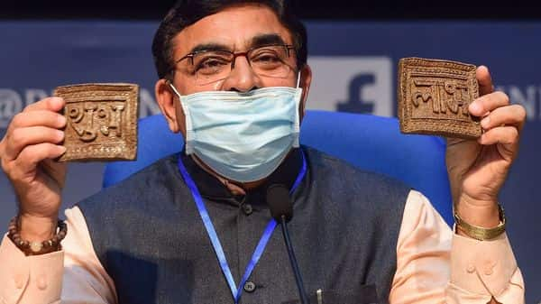 Vallabhbhai Kathiria, Chairman, Rashtriya Kamdhenu Aayog, shows cow- dung based Diwali articles during a news conference Kamdhenu Deepawali campaign, in New Delhi. (PTI)