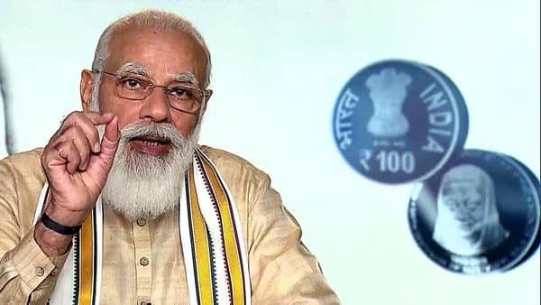 Prime Minister Narendra Modi addresses after releasing a commemorative coin of  ₹100 in honour of Rajmata Vijaya Raje Scindia,