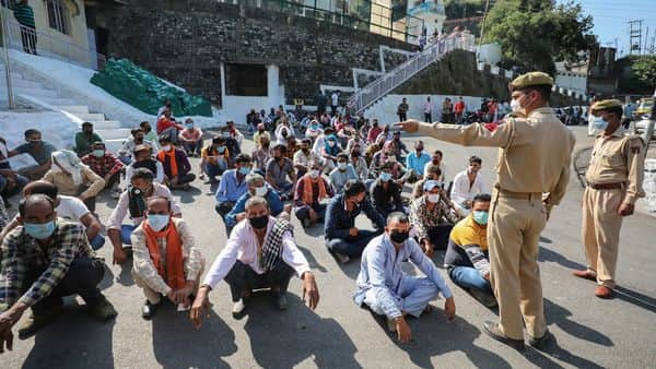 Jammu: 'Palki', 'pitthu' and pony servicemen wait to undergo COVID-19 tests, as authorities have allowed them to resume their services for Mata Vaishno Devi pilgrims, (PTI)