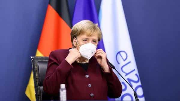 Germany's Chancellor Angela Merkel removes her mask for the EU summit final news conference at the European Council building in Brussels, Belgium October 16, 2020. (REUTERS)