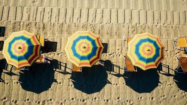 Bird's eye view of colored umbrella in a beach in italy, Tuscany,Viareggio