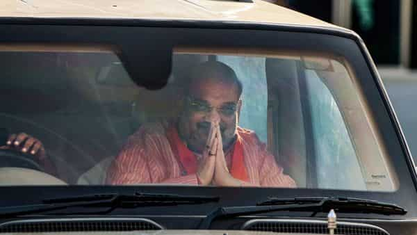Ahmedabad: Union Home Minister Amit Shah arrives at Sardar Vallabhbhai Patel International Airport, in Ahmedabad, Tuesday, Oct. 13, 2020. (PTI Photo)(PTI13-10-2020_000156B) (PTI)