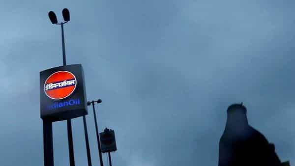 A woman walks past a logo of Indian Oil outside a fuel station in New Delhi, India, August 29, 2016. REUTERS/Adnan Abidi/Files (REUTERS)