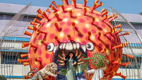 South Dinajpur: An idol of Goddess Durga at coronavirus theme-based community puja pandal for worship ahead of the Durga puja festival, at Balurghat in South Dinajpur district. (PTI)