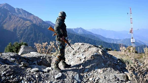 An Indian Army soldier stands guard (AFP)