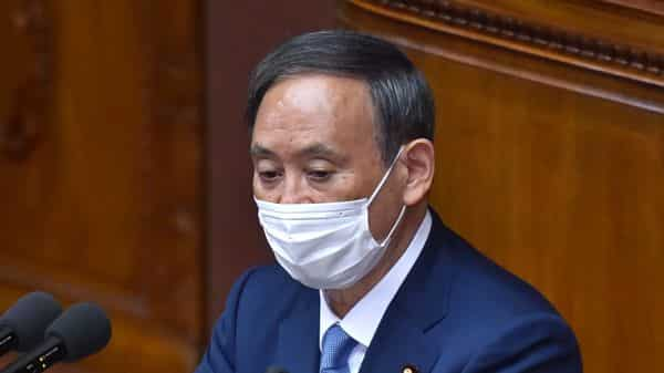 Prime Minister Yoshihide Suga Suga did not give precise details on how Japan would meet the deadline but said technology would be essential (AFP)