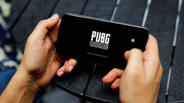 A boy plays Tencent Holdings' PUBG videogame on his mobile phone. (REUTERS)