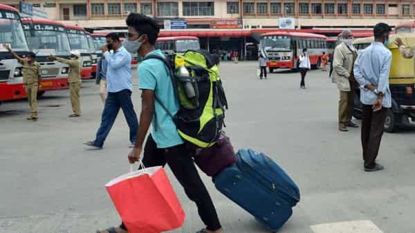 Migrant from various states return back to Bengaluru as a Large number of migrants were gone out of the city to their native places during the lockdown, in Bengaluru.