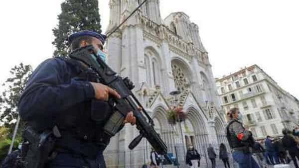 A French police officers stands near Notre Dame church in Nice (AP)