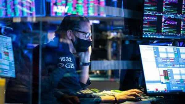 In this photo provided by the New York Stock Exchange, specialist Gregg Maloney works at his post on the trading floor. (AP)