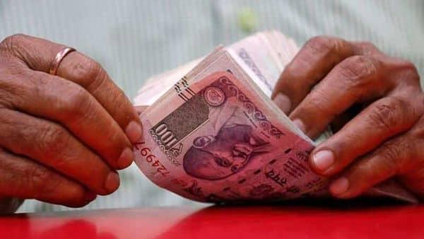 A man counts rupee notes inside a shop in Mumbai. (REUTERS)