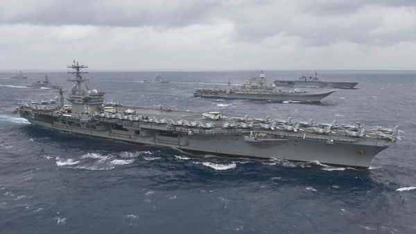 This US Navy handout photo obtained July 18, 2017 shows the aircraft carrier USS Nimitz (CVN 68) as it leads a formation of ships from the Indian navy, Japan Maritime Self-Defense Force (JMSDF) and the US Navy in the Bay of Bengal as part of Exercise Malabar 2017 (AFP)