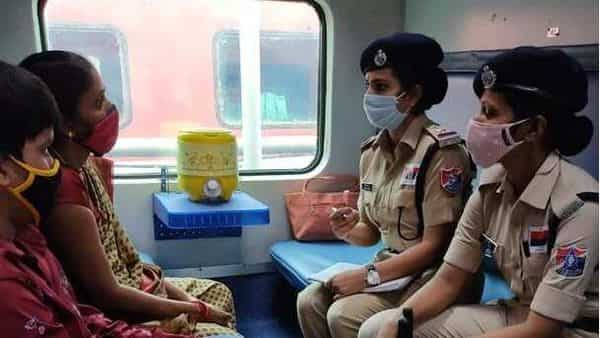 Lady passengers giving their journey details to RPF personnel