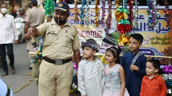 Mumbai: A policeman takes selfie with children during Eid-e-Milad-un-Nabi celebrations (PTI)