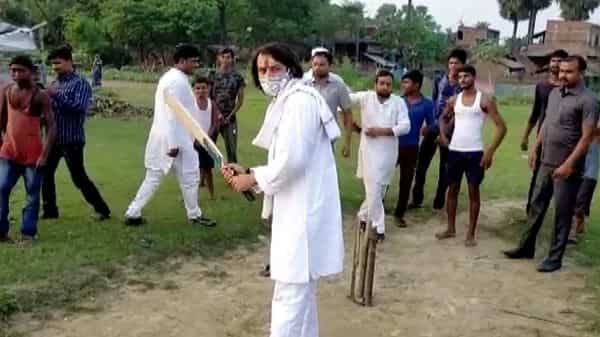 RJD leader Tej Pratap Yadav plays cricket with children in Hasanpur Assembly constituency while campaigning for his party in Hasanpur.